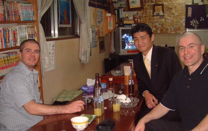 Fine dining at Yokota's Okonomiyaki near Hombu in November 2003